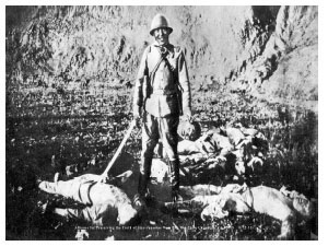Japanese soldier with Chinese corpses